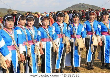 Heqing, China - March 15, 2016: Chinese Women In Ancient Bai Yi Clothing During The Heqing Qifeng Pe