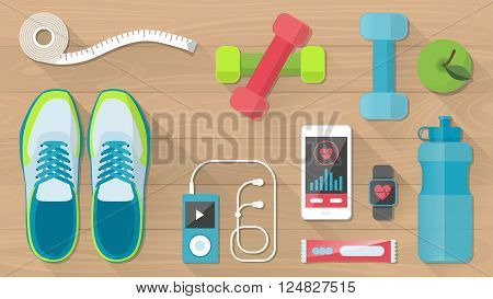 Sports and physical activity equipment healthy food and wellness banner objects set on a wooden floor top view