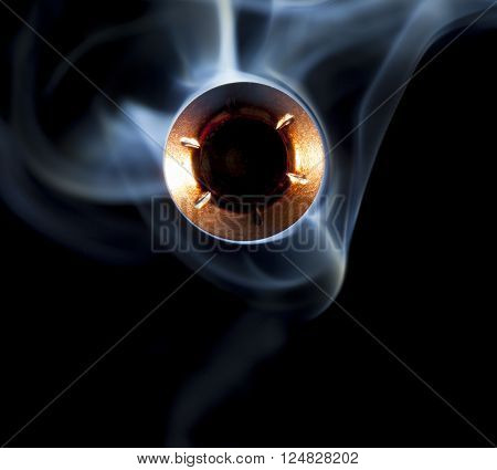 Bullet with a hollow point and smoke coming at the camera
