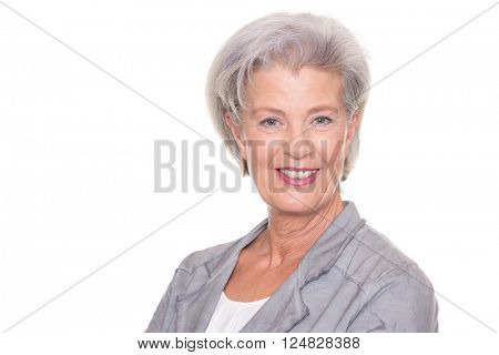 Happy and successful senior woman in front of white background