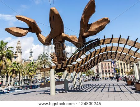 SPAIN, BARCELONA, MARCH, 20, 2016 - Gambrinus- giant happiest lobster sculpture with big pinching claws and a cheeky smile on Passeig de Colom at the Port Olympic, commissioned for the 1992 Barcelona Games. in Barcelona, Catalonia, Spain