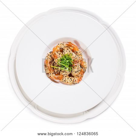 Delicious grilled jumbo shrimps with sesame and sliced scallions. Isolated on a white background.