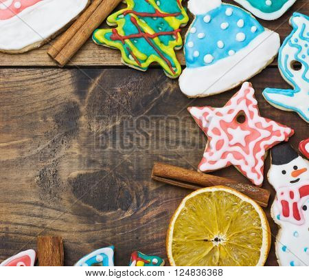 Christmas gingerbread home cooking on a wooden table