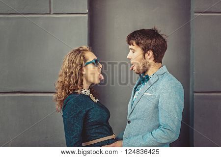 Portrait of happy hipster couple in love with tongues