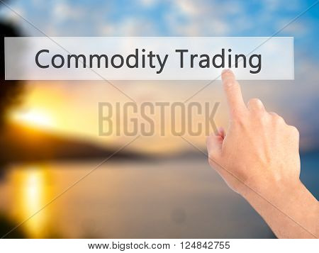 Commodity Trading - Hand Pressing A Button On Blurred Background Concept On Visual Screen.