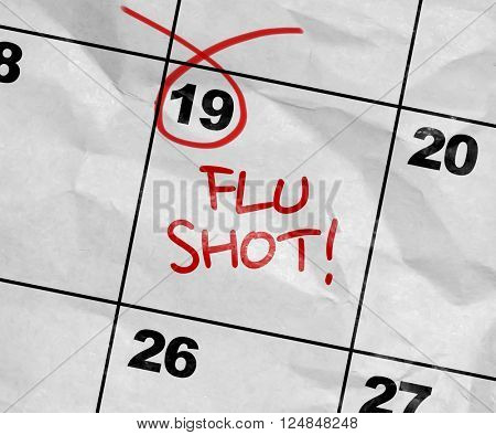Concept image of a Calendar with the text: Flu Shot