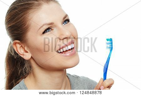 Closeup of pretty woman with perfect healthy teeth holding brush. Dental care. Fresh breath concept.