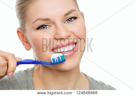 Pretty woman with toothbrush and paste. Healthy teeth concept.