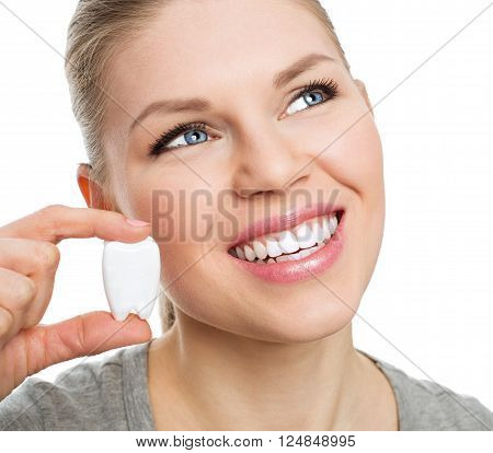 Portrait of beautiful Caucasian female showing molar model. Dental health and regular checkup concept. poster