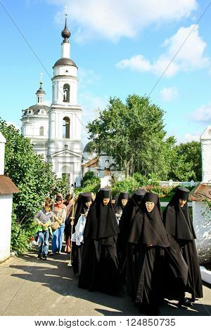 MALOYAROSLAVETS RUSSIA - AUGUST 19 2012: Nuns take part in the religious procession in Monastery of St. Nicholas in the ancient Russian city Maloyaroslavets. For editorial use only.