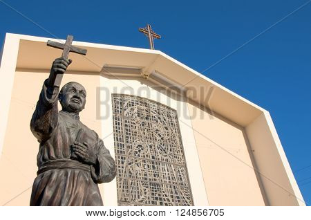 San Gabriel California USA./April 3 2016: Photo of Mission San Gabriel Arcangel with statue of Junipero Serra