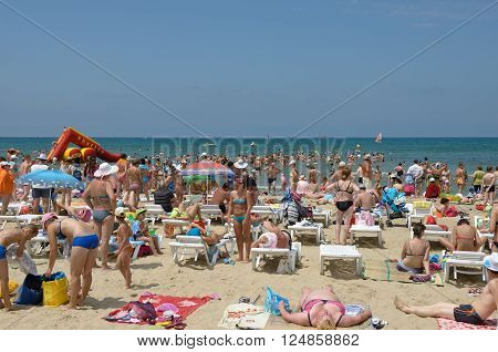 ANAPA, RUSSIA - JULY 05: Many resort vacationers are enjoying under summer sun on Central municipal beach on July 05, 2015 in Anapa, Russia.