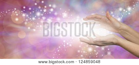 The Magic of Healing - female parallel hands with a burst of white light between and outwardly flowing sparkles on a pink purple background with plenty of copy space poster