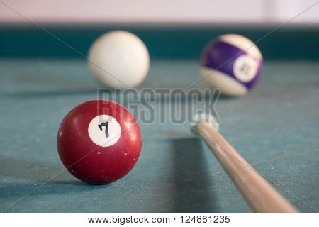 Billard balls on a green billard table