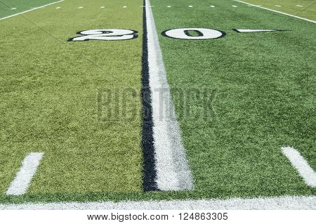 Twenty yard line on a turf football field from the sideline.