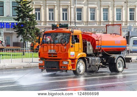 MOSCOW, RUSSIA - MAY 6, 2012: Red watering and cleaning machine KAMAZ 53605 in the city street.