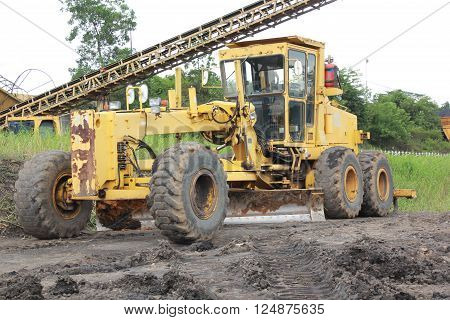 Grader in the coal mine site which still operate