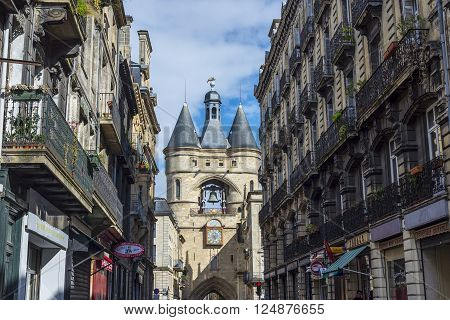 Bordeaux France - March 26 2016. Typical street of Bordeaux with Eglise catholique Saint-Eloi church in background. Bordeaux Aquitaine. France.