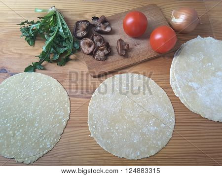 Cooking tortillas for dandelion mushrooms tomato rolls