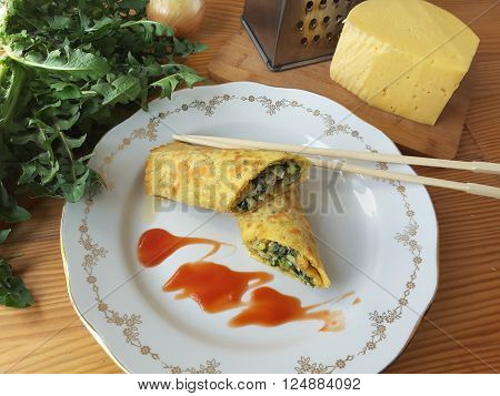 Dandelion shrimp cheese rolls on a table decorated with tomato sause