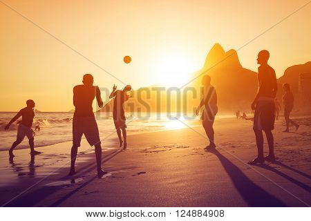 Rio de Janeiro, Brazil - Circa February 2016: Silhouette of unidentified locals playing ball at sunset in Ipanema beach, Rio de Janeiro, Brazil.
