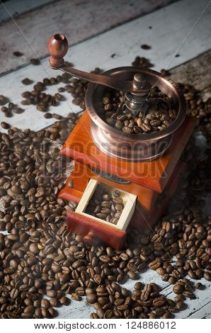 Coffee Grinder With Roasted Beans. Vintage Mill Composition