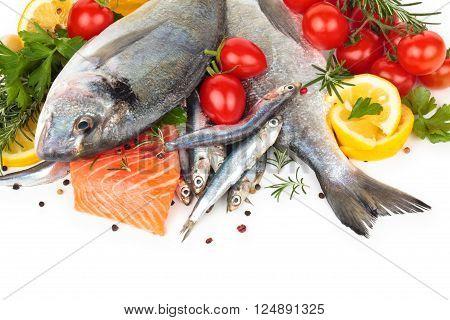 Fresh fish with lemon and parsley. Isolated on white background.