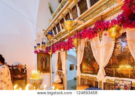KYTHNOS GREECE - AUGUST 14 2014: Decorated iconostasis (templon) of the church of Panagia Stratolatissa with needleloom embroidery and bougainvillea flowers