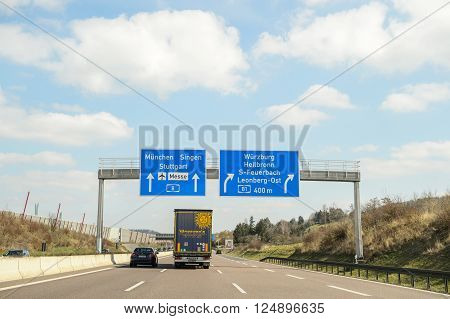 GERMANY - MAR 26 2016: Bundesautobahn or Federal Motorway highway street signsign. It runs through the German states of Hessen and Baden-Württemberg and connects on its southern ending to the Swiss A 2.Construction was started on 23 September 1933 by Adol