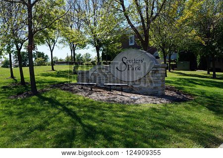 PLAINFIELD, ILLINOIS / UNITED STATES - SEPTEMBER 20, 2015: People may enjoy Settlers' Park in downtown Plainfield.