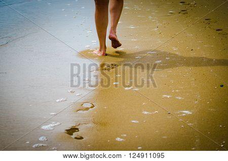 Beautiful female a foot in the beach