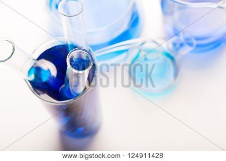 Test tubes with chemical reagent (or water) on white background