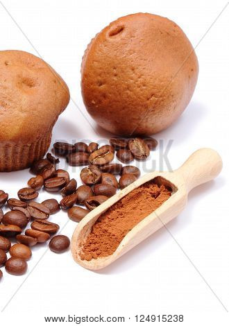 Fresh baked coffee muffins coffee grains and powdery cinnamon on wooden spoon. Isolated on white bakcground
