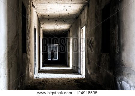 Abandoned building ghost living place with scary woman inside, darkness horror and halloween background concept