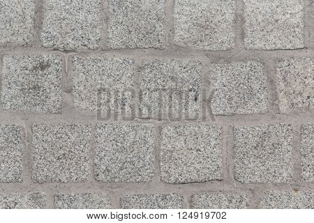 architecture, stonework and tiled masonry concept - close up of paving stone or facade tile texture