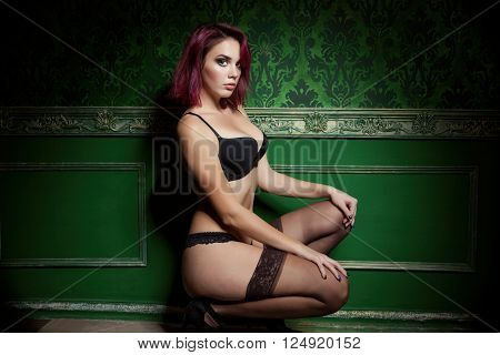 Sexy Readhead In Provocative Lingerie On Vintage Wall