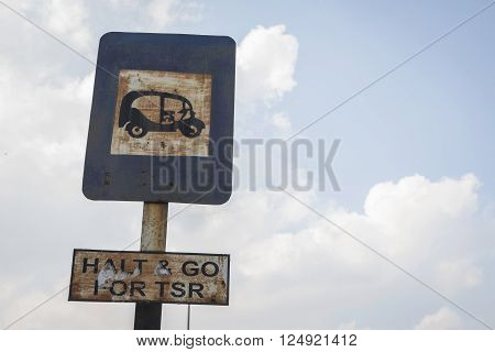 old signs for autorickshaw in sky background, autorickshaw is name of taxi in india