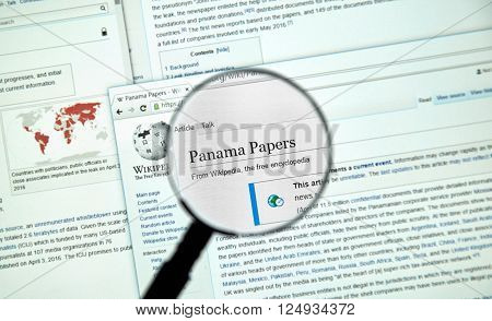 MONTREAL CANADA - APRIL 7 2016 : The Panama Papers article on Wikipedia under magnifying glass. The Panama Papers is set of 11.5 million leaked confidential documents.