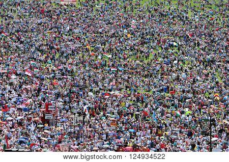 SUMULEU CIUC ROMANIA - JUNE 6 2014: Crowd of Hungarian Catholic pilgrims gathering in Csiksomlyo to celebrate the Pentecost