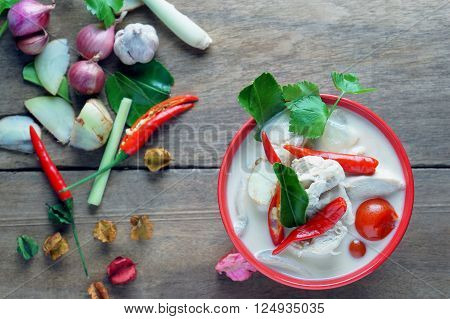 Thai style coconut milk soup with chicken in red cup, (Tom Kha Gai ),select focus