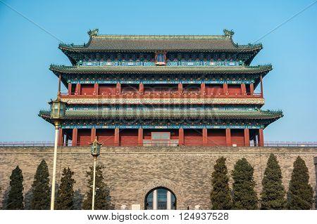 Beijing, China at the Zhengyangmen Gatehouse in Tiananmen Square. Beautiful historical building at sunset.
