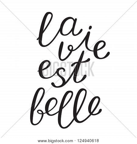 La vie est bell, life is beautiful in French. Brush hand lettering. Brush calligraphy. Handwritten word in French.