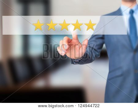 Five Star Rating - Businessman Hand Pressing Button On Touch Screen Interface.