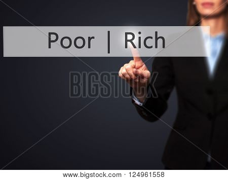 Poor  Rich - Businesswoman Hand Pressing Button On Touch Screen Interface.