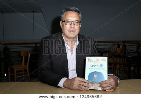 HUNTINGTON, NY-APR 6: Former New York Mets pitcher Ron Darling signs his book