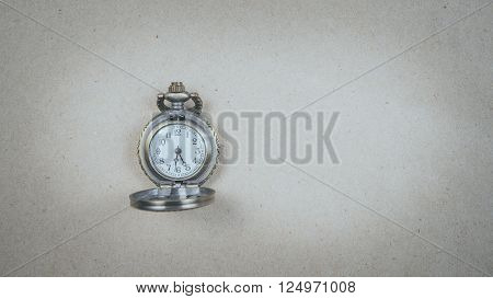 a small clock locket used as part of a charm braclet