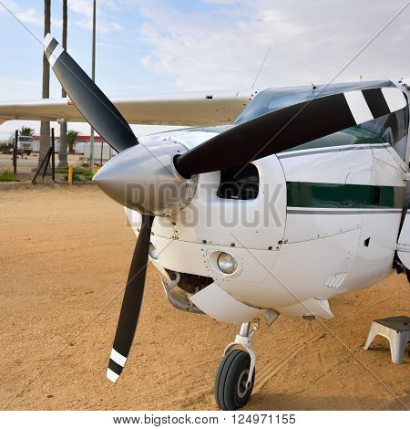 SWAKOPMUND NAMIBIA - JAN 31 2016: Cessna airplane on the small airport near Swakopmund. Popular tourist attraction in Namibia - flight safaris above Namib desert