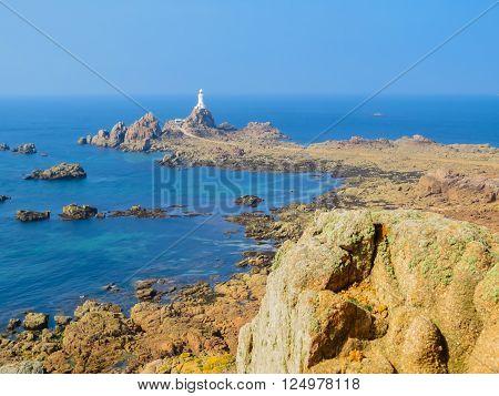 La Corbiere Lighthouse on the rocky coast of Jersey Island, Channel Islands poster