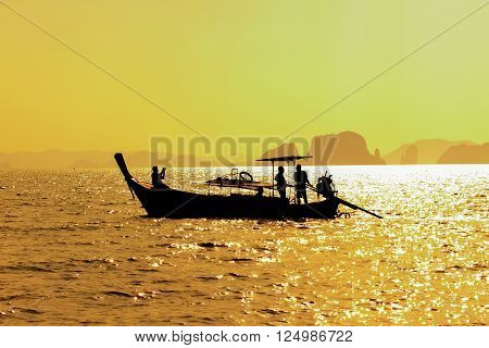 Longtail boat on sunrise on the coast of Andaman sea in Thailand