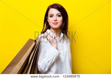 Portrait Of Young Woman With Shopping Bags